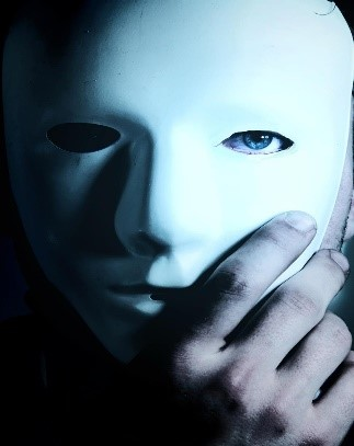 Photo of a man wearing a white plastic mask